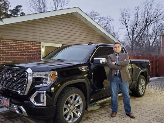 Shawn O'Leary stands in front of his 2019 GMC Sierra Denali pickup in which the electronic braking system had failed. GM has a fix now for that problem, which O'Leary got earlier this month. So far it has been fine, but he said he is still nervous to drive it and his wife will not allow their children to ride in it.