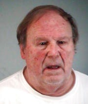 In this Monday, Jan. 27, 2020 photo made available by the Lake County Sheriff's Office, Wolfgang Halbig is under arrest.