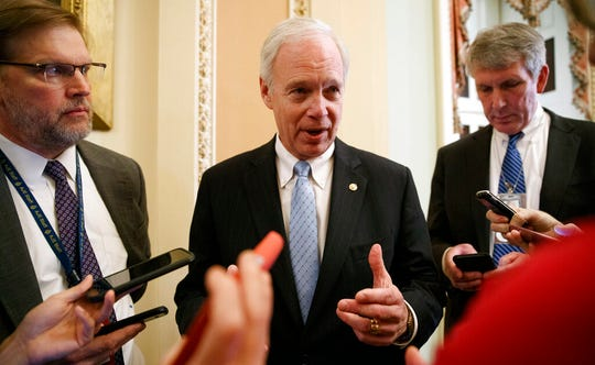 Sen. Ron Johnson, R-Wis., speaks to reporters, Monday, Jan. 27, 2020, on Capitol Hill in Washington, about the impeachment trial of President Donald Trump.