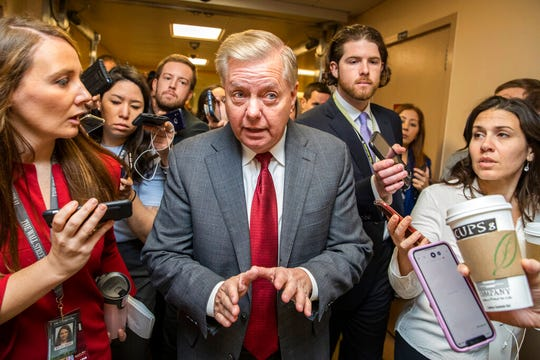 Sen. Lindsey Graham, R-S.C., speaks to reporters as he arrives at the Capitol in Washington, Monday, Jan. 27, 2020, during the impeachment trial of President Donald Trump.