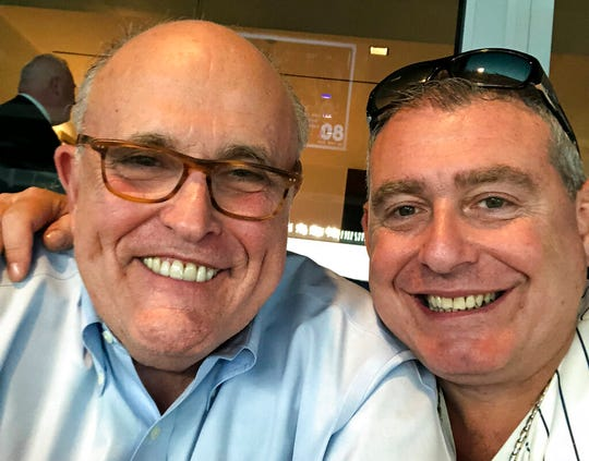 This undated image released by the House Judiciary Committee from documents provided by Lev Parnas to the committee in the impeachment probe against President Donald Trump, shows a photo of Lev Parnas, right, with Rudy Giuliani.