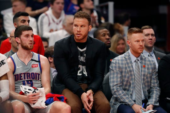 Detroit Pistons forward Blake Griffin, wearing a jersey in tribute to Kobe Bryant sits with guard Sviatoslav Mykhailiuk (19) and assistant coach Sean Sweeney during the first half.