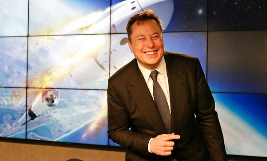 In this Jan. 19, 2020, file photo Elon Musk, founder, CEO, and chief engineer/designer of SpaceX speaks during a news conference at the Kennedy Space Center in Cape Canaveral, Fla. The meteoric rise of Tesla shares that pushed the company's value over $100 billion could turn into a supercharged payday for CEO Elon Musk.