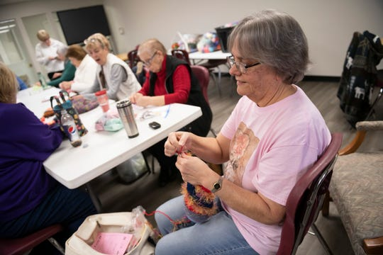 Melanie Bieganski and the Kibitz and Knits knitting club make Twiddlemuffs at the Westfield Activiies Center, in Trenton, January 27, 2020.  Twiddlemuffs are a knitted hand cover that provide a distraction or calming effect for people with mental disabilities.