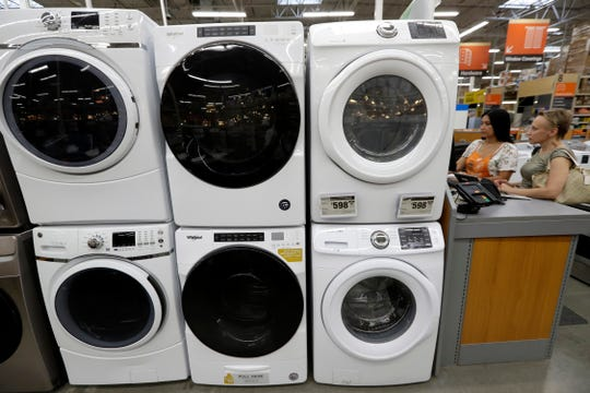 Clothes dryers, top, are stacked on top of washing machines at a Home Depot store in Boston.