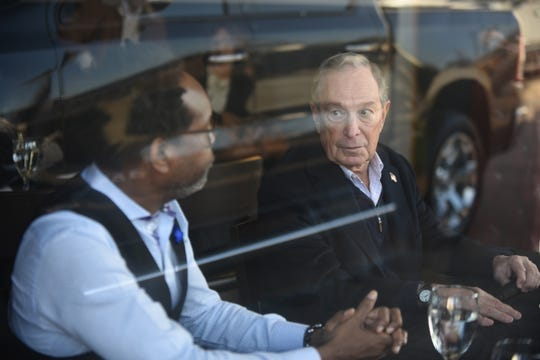 Derrick Bartell (left), owner of Simplycasual, speaks with Democratic Presidential candidate Mike Bloomberg during a visit at Good Times along Detroit's Avenue of Fashion on Saturday, December 21, 2019 while Bloomberg was in the city campaigning.