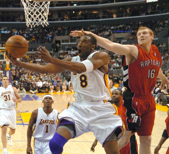 The Raptors' Matt Bonner can't stop the Los Angeles Lakers' Kobe Bryant from getting to the basket in the first half of a 2006 game in which the Lakers star poured in 81 points.