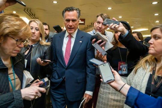Sen. Mitt Romney, R-Utah, speaks to reporters as he arrives at the Capitol in Washington, Monday, Jan. 27, 2020.