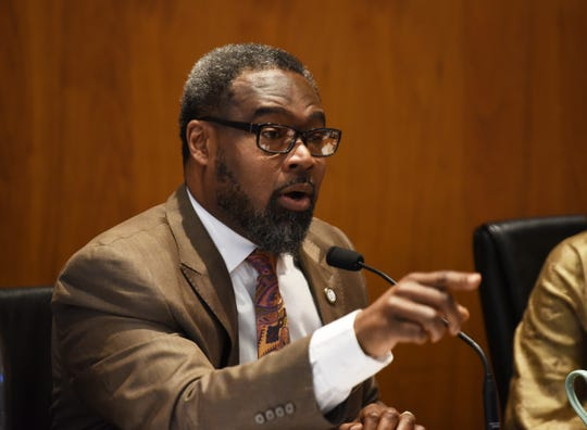 Councilman James Tate answers questions from the public during the hearing for recreational marijuana businesses in the city.