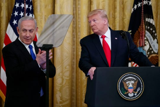 President Donald Trump pauses while speaking during an event with Israeli Prime Minister Benjamin Netanyahu in the East Room of the White House in Washington, Tuesday, Jan. 28, 2020, to announce the Trump administration's much-anticipated plan to resolve the Israeli-Palestinian conflict.
