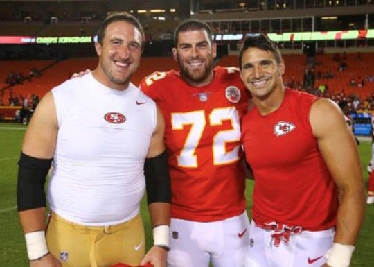 Former Central Michigan stars Joe Staley, Eric Fisher and Frank Zombo get together for a photo after an NFL game in 2018.