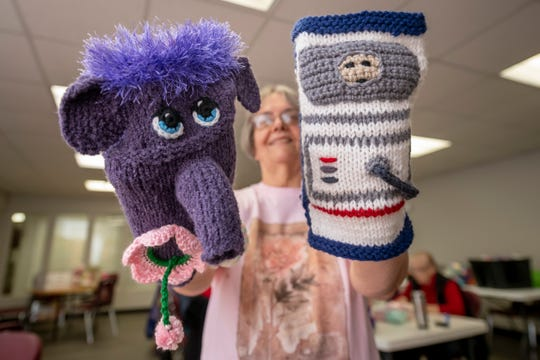 Melanie Bieganski demonstrates a pair of Twiddlemuffs at the Westfield Activiies Center, in Trenton, January 27, 2020.  Twiddlemuffs are a knitted hand cover that provide a distraction or calming effect for people with mental disabilities.