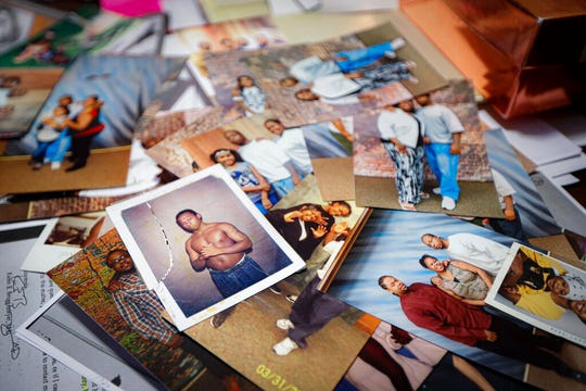 Family photos of Myon Burrell during his teenage years before and after incarceration are displayed a the home of his sister, Ianna, in Shakopee, Minn., Friday, Oct. 25, 2019.