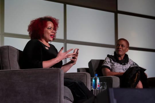 Nikole Hannah-Jones, left, is interviewed by journalist Rochelle Riley on Tuesday for a discussion of Hannah-Jones' 1619 Project at Rackham Auditorium. She said that she chose the project because she was thinking about the date 1619 since she learned of its significance in high school during a black studies course.