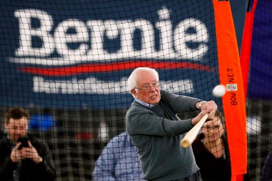 Democratic presidential candidate Sen. Bernie Sanders, I-Vt., hits a baseball after a meeting with minor league baseball players and officials at FunCity Turf, Sunday, Dec. 15, 2019, in Burlington, Iowa.