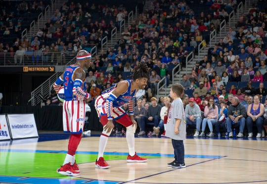 The Harlem Globetrotters, pictured during the 2019 Fan Powered World Tour, will stop at Elmira's First Arena on Wednesday.