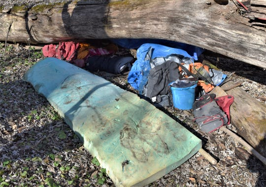 More than 300 pounds of garbage and debris were left behind in an abandoned camp found recently along the Chemung River, the second such find in two months.