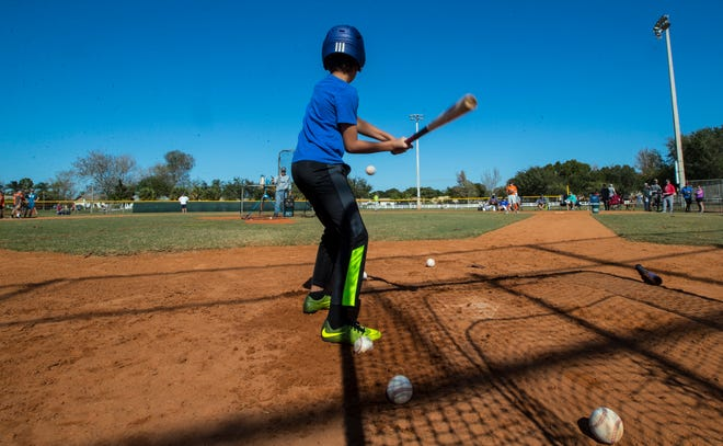 Kamden Kimbrough, 9, participates in batting drills while trying out for the South Fort Myers Youth Baseball league at Rutenberg Park, Saturday, January 25, 2020. Participants competed in catching, running, throwing and hitting drills.