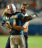 Miami Dolphins head coach Dave Wannstedt, right, congratulates running back Ricky Williams during a 2003 game. Wannstedt, a Naples resident, coached the Dolphins from 2000-04. He's now a TV analyst for FOX Sports and will be back in Miami to cover Super Bowl LIV this week.