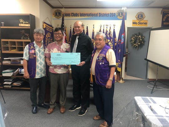 Copy Express CEO John Yang and CFO Daniel Yang donated $10,000 to help purchase a mobile health clinic for the Guam Tano Ta Lions Club and District 204.