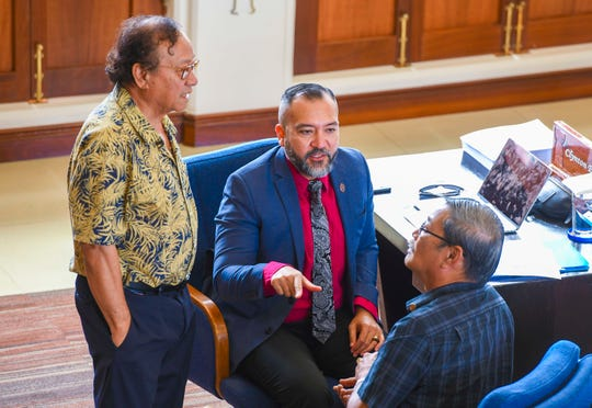"""From left, Sens. Jose """"Pedo"""" Terlaje, Clynt Ridgell and Joe San Agustin confer during a recess called at session at the Guam Congress Building on Hagåtña in this Jan. 28 file photo"""