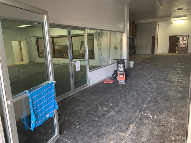 The floors at the entrance to the Pacific Arcade Building, formerly used by the Guam Legislature, have been stripped by contractors working to renovate the building, which is being purchased by the government of Guam through a federal grant for use as office space. The former public hearing room, at left, will be a shared conference room.