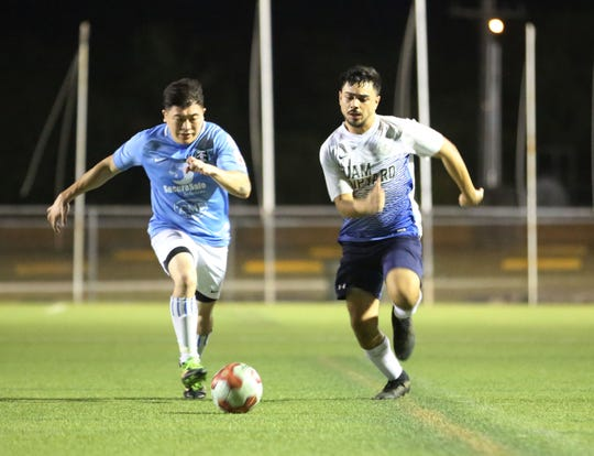 Guam Shipyard's Kevin Leasiolagi and Sidekicks SC's Brandon Lujan sprint to gain possession of the ball during a Week 9 match of the Budweiser Soccer League Premier Division on Saturday at the Guam Football Association National Training Center. Guam Shipyard won 3-1.