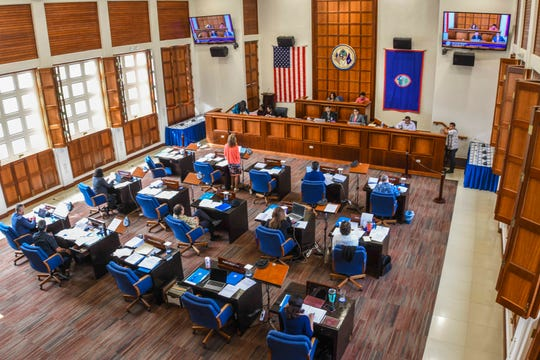 Guam lawmakers gather during session called at the Guam Congress Building on Hagåtña on Tuesday, Jan. 28, 2020.