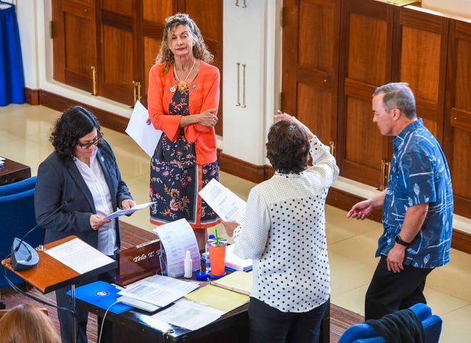 Guam legislative senators, from left, Sens. Sabina Perez, Kelly Marsh, Telo Taitague and James Moylan, confer with one another during a recess called at session with other island lawmakers at the Guam Congress Building on Hagåtña on Tuesday, Jan. 28, 2020.