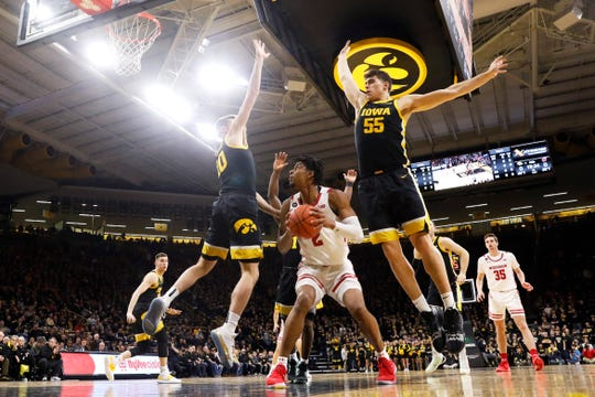 Iowa's eight-man rotation (including Joe Wieskamp, left, and Luka Garza) has bought in defensively, and it's showing up at the end of games.