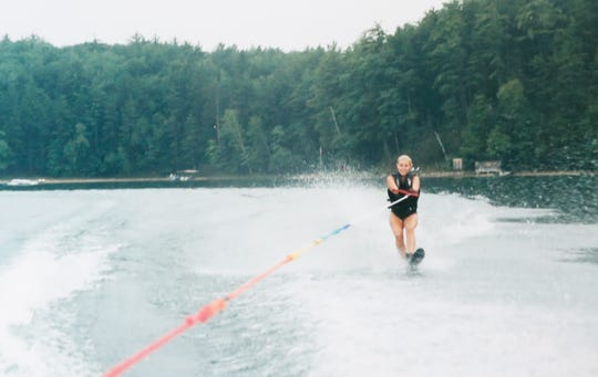 Kira Hudson, a survivor of two car crashes involving distracted driving and cellphones, is shown water-skiing before the car accident, which paralyzed her. Hudson crashed her car while talking on her cellphone. Years later, she was hit by another distracted driver on their own cellphone.