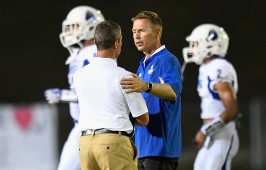 Kevin Wright (in blue) helped build a powerhouse program at Florida's IMG Academy.