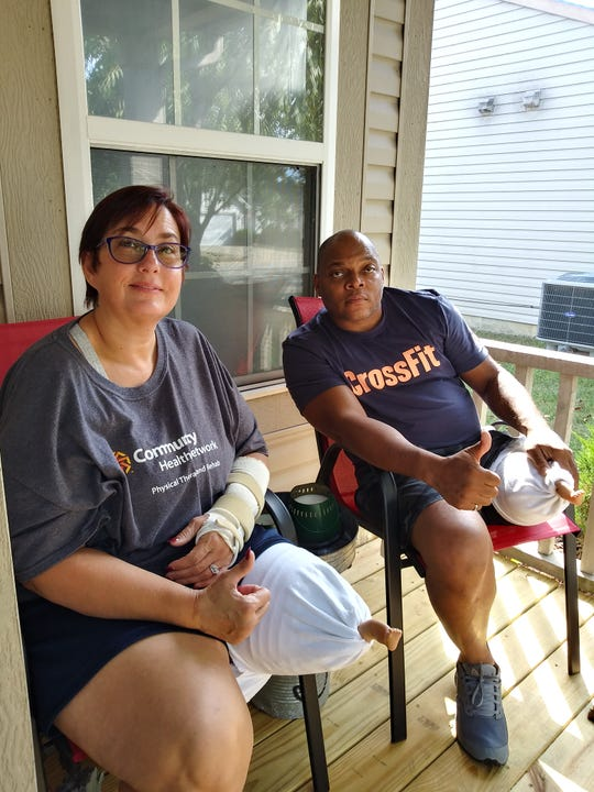 Tina and Lorin Smith of Indianapolis recover after a distracted driver hit them when they were stopped on their motorcycles on the side of U.S. 40.