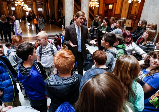 Jeff Dukes, director of Purdue Climate Change Research Center, talks with students during the Youth Climate Action Day.
