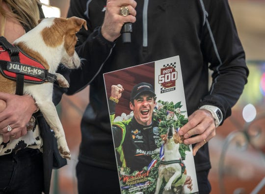 A fun mini ticket featuring Norman, the dog of Simon and Hailey Pagenaud, at the unveiling of this year's Indianapolis 500 ticket, a design featuring race cars and Simon, during a ceremony at City Market, Indianapolis, Tuesday, Jan. 28, 2020.