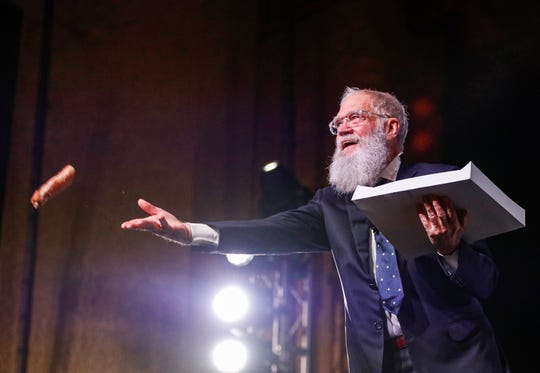 David Letterman tosses donuts to the audience at the Madam Walker Legacy Center in Downtown Indianapolis, Tuesday, Jan. 28, 2020. Letterman received the Bill McGowan Leadership Award and later sat down for a Q&A.