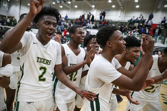The Crispus Attucks Tigers celebrate seconds after defeating Cathedral Fighting Irish for the City tournament title in double overtime, 94-91, at Arsenal Technical High School in Indianapolis on Monday, Jan. 27, 2020. This is the first City tournament title for Crispus Attucks since 1961-62.