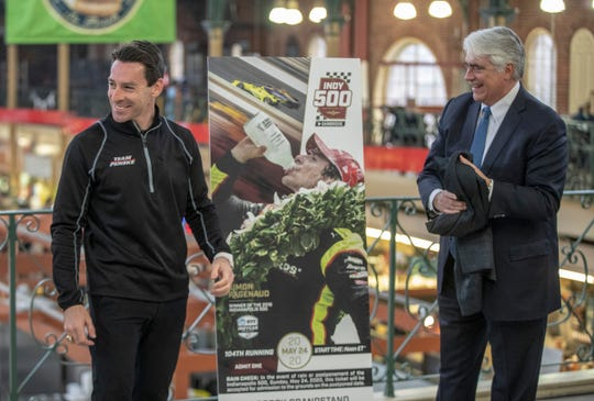 Simon Pagenaud, reigning winner of the Indianapolis 500, and Mark Miles smile at the unveiling of this year's Indianapolis 500 ticket during a ceremony at City Market, Indianapolis, Tuesday, Jan. 28, 2020.