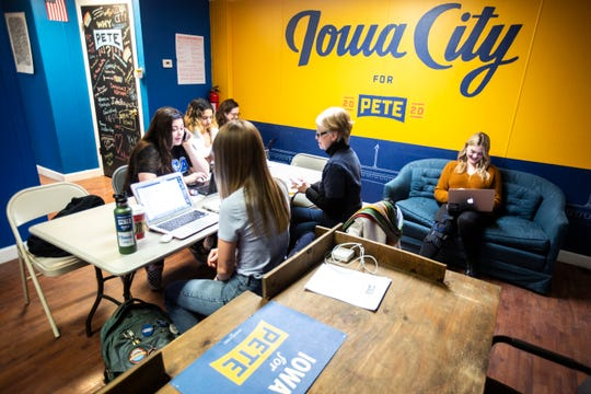 Volunteers and organizers make phone calls promoting an upcoming event, Friday, Jan. 24, 2020, at a field office for Democratic presidential candidate Pete Buttigieg in Iowa City, Iowa.