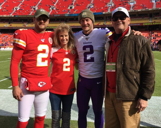 Brothers Dustin Colquitt of the Kansas City Chiefs, left, and Britton Colquitt of the Minnesota Vikings and their parents Anne and Craig Colquitt before a game on Nov. 3, 2019 at Arrowhead Stadium in Kansas City.