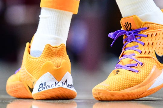 """""""Black Mamba,"""" a nickname of Kobe Bryant's, is written on Tennessee guard Davonte Gaines' basketball shoe along with purple shoelaces ahead of a game between Tennessee and Texas A&M at Thompson-Boling Arena in Knoxville, Tennessee on Tuesday, January 28, 2020."""