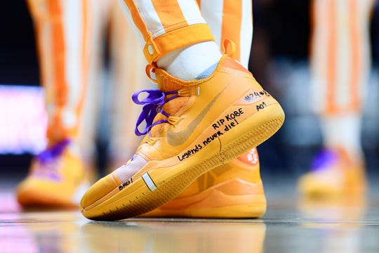 """RIP Kobe Legends never die!"" reads Tennessee forward Uros Plavsic's shoe along with purple shoelaces in honor of the late basketball player ahead of a game between Tennessee and Texas A&M at Thompson-Boling Arena in Knoxville, Tennessee on Tuesday, January 28, 2020."