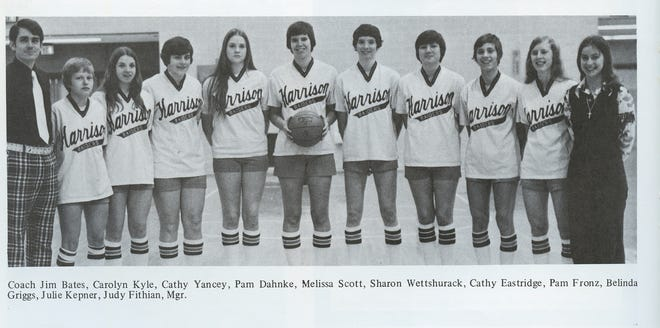 A photo taken from the 1975 Harrison High School yearbook, The Prophet, of the 1974-75 Raider girls basketball team, from left, Coach Jim Bates, Carolyn Kyle, Cathy Yancey, Pam Dahnke, Melissa Scott, Sharon Wettshurack, Cathy Eastridge, Pam Franz, Belinda Griggs, Julie Kepner, Judy Fithian, Mgr.