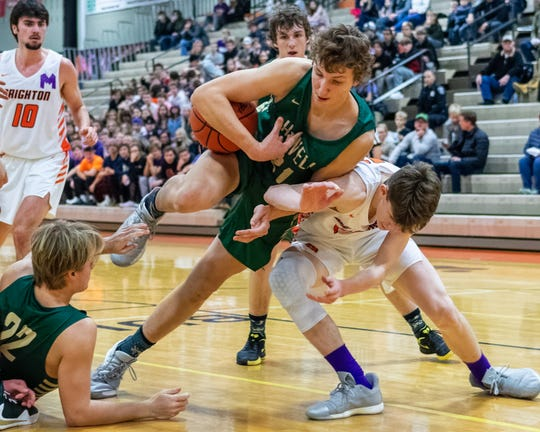Basketball games between rivals like Howell and Brighton don't typically fill the bleachers because fans are split between the boys and girls varsity games on the same nights.
