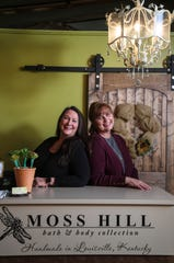 """Teri Amsler, left, and Jeanine Moneypenny, best friends since the mid 1970s, co-own Moss Hill bath & body products inside Work The Metal in Butchertown. The pair would write letters to each other as teens. """"Itell my daughters, you don't know how fun it was writing notes, and going back 20 or 30 years later and reading them,"""" Moneypenny said. Jan. 28, 2020"""