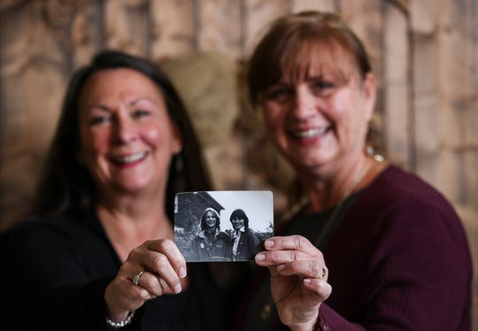 """Teri Amsler, left, and Jeanine Moneypenny hold a photo of themselves that was taken in 1977. Teri was 15 at the time; Jeanine was 14. The pair would write letters to each other as teens. """"I tell my daughters, you don't know how fun it was writing notes, and going back 20 or 30 years later and reading them,"""" Moneypenny said."""