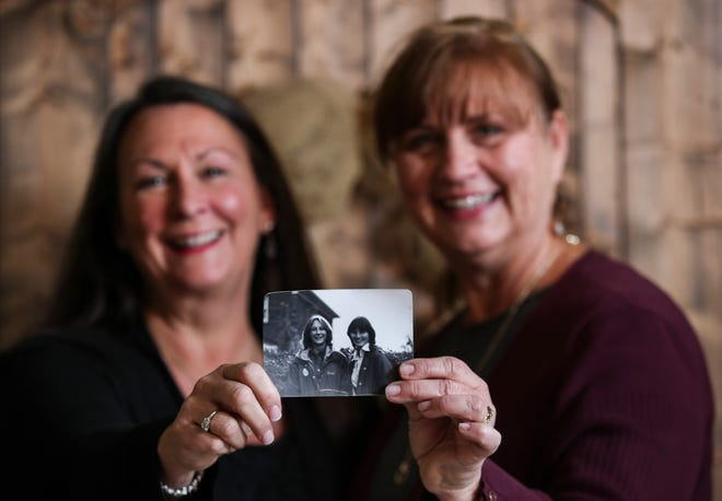 "Teri Amsler, left, and Jeanine Moneypenny hold a photo of themselves that was taken in 1977. Teri was 15 at the time; Jeanine was 14. The pair would write letters to each other as teens. ""I tell my daughters, you don't know how fun it was writing notes, and going back 20 or 30 years later and reading them,"" Moneypenny said."