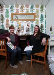 Jeanine Moneypenny, left, and Teri Amsler have been best friends since the mid-1970s and work together in a small office inside their Moss Hill store in Butchertown.