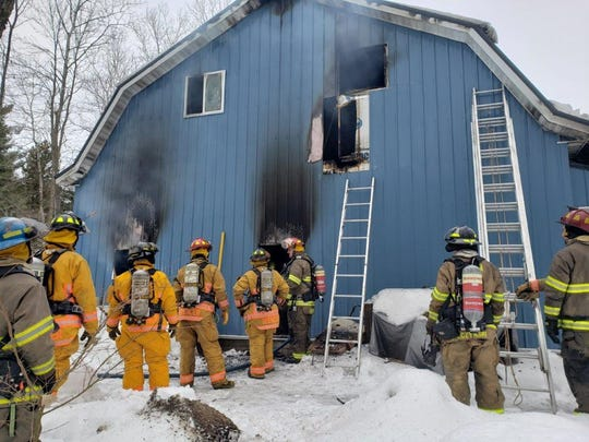 Firefighters put out a shed fire on Ader Lane in the town of Richfield Monday, January 27, 2020.