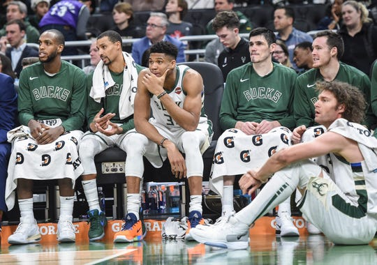 Milwaukee Bucks forward Khris Middleton (22), guard George Hill (3), forward Giannis Antetokounmpo (34), forward Ersan Ilyasova (7) and center Robin Lopez (42) rest during a game against the Cleveland Cavaliers in the fourth quarter at Fiserv Forum.